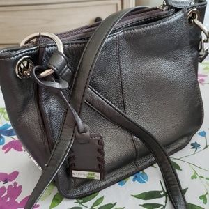 Tignanello Cross Body Bag. Multi compartments